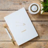Notes v tvrdých deskách bílý se znamením BÝK,  21,5x15,5x1cm